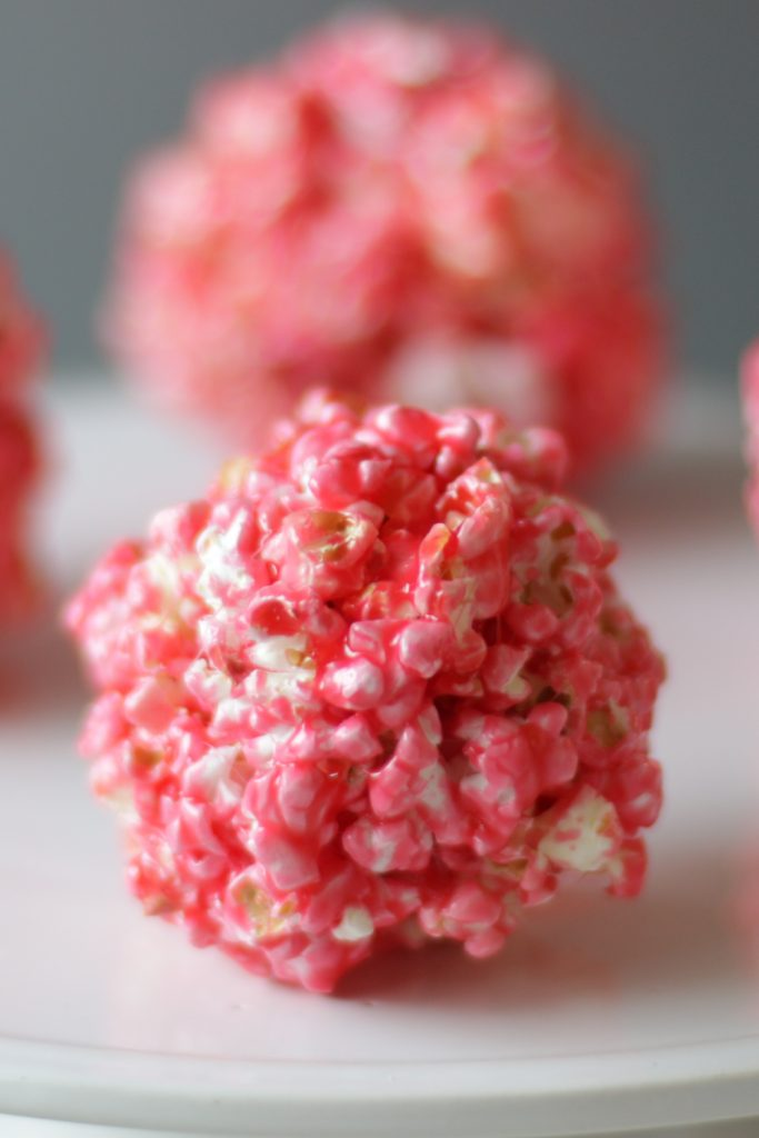 Popcorn balls on a white plate.