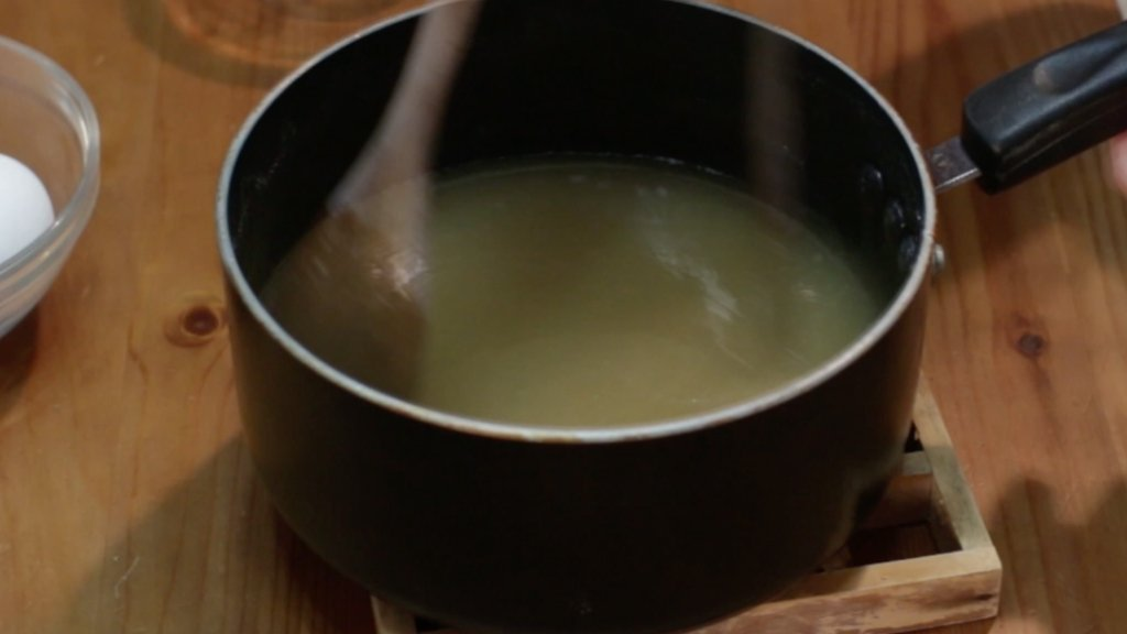 Butter and vanilla extract added to the hot melted sugar.