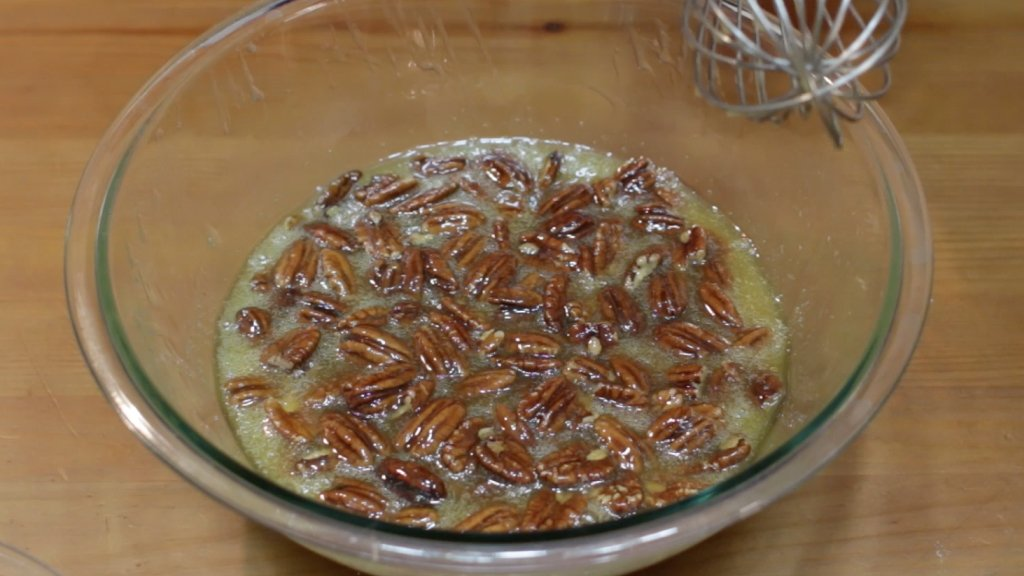Easy homemade pecan pie filling in a large glass bowl.