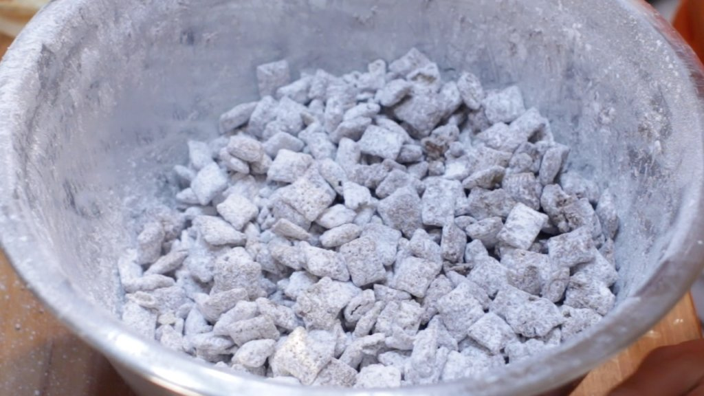 Large bowl of finished puppy chow muddy buddies.