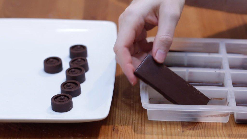 Hand holding a homemade chocolate bar.