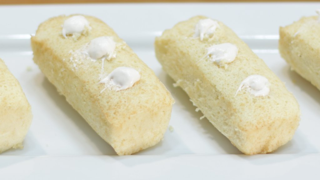 White plate with four homemade Twinkies on it.