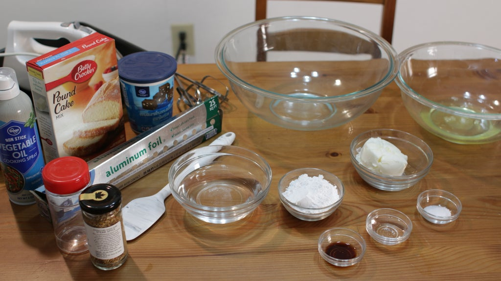 Several ingredients on a wooden table in bowls.