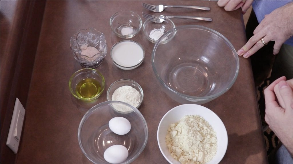 Several gluten-free and dairy-free ingredients in bowls on a counter.