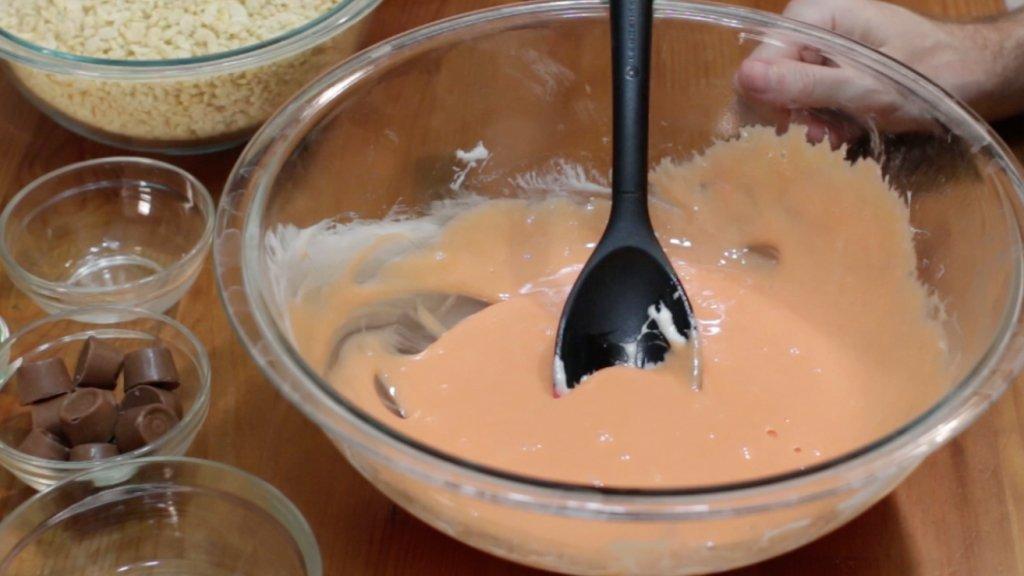 Large bowl full of orange melted marshmallows