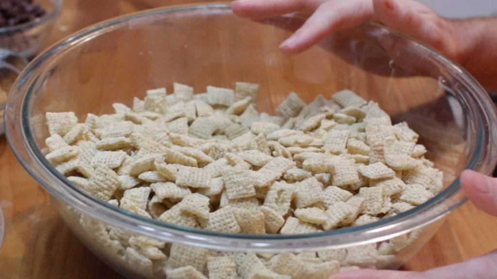 Large glass bowl full of rice Chex.