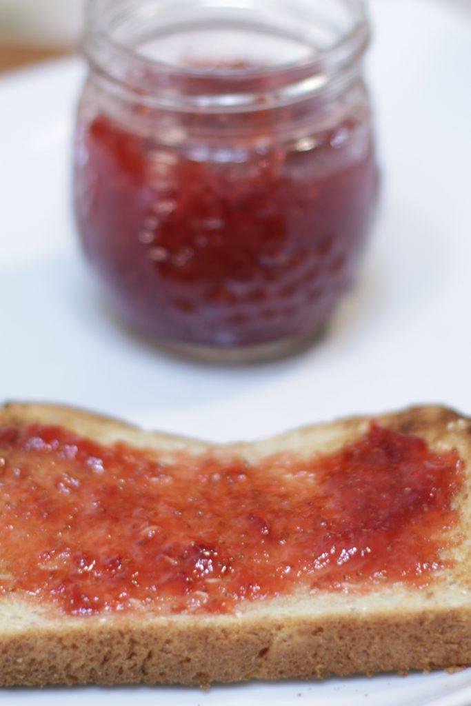 Fresh homemade three ingredient strawberry jam on a slice of toast.