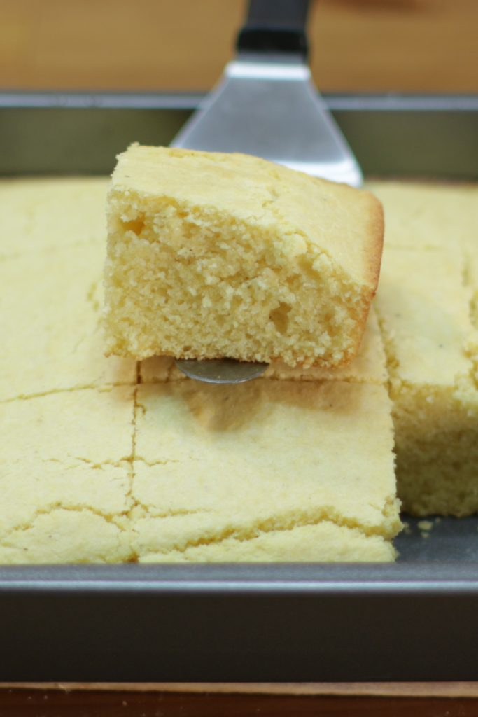 Easy basic cornbread in a square metal pan.
