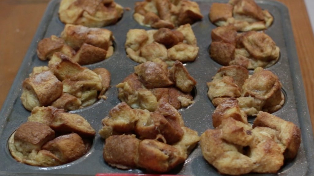Freshly baked French toast bites in a muffin pan.