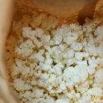 homemade microwave popcorn in a brown paper bag.