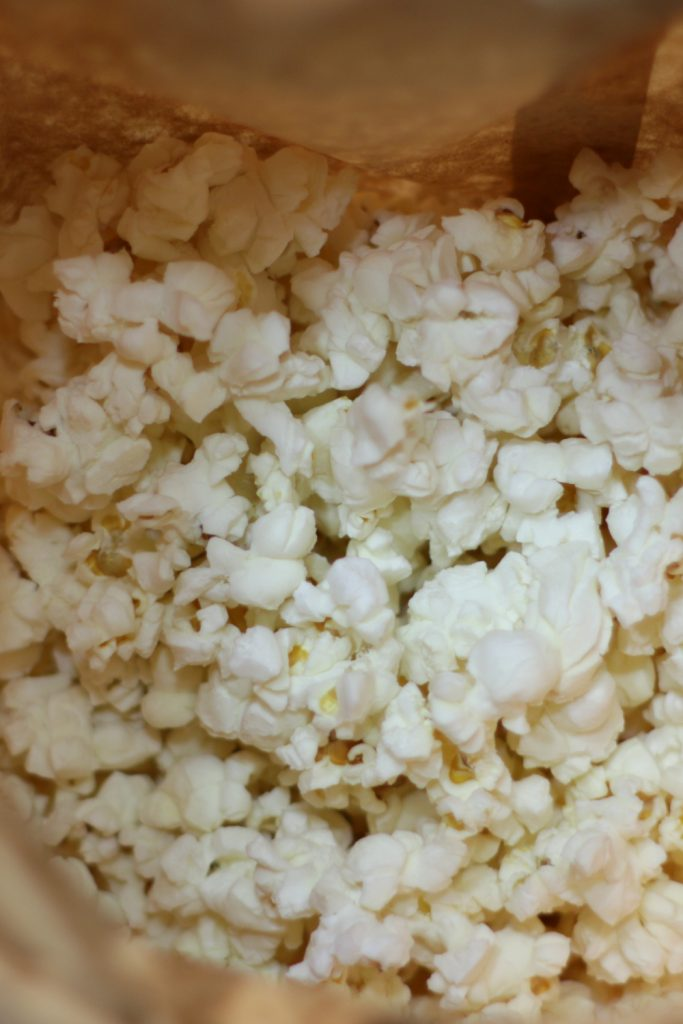 Brown paper bag of homemade microwave popcorn.