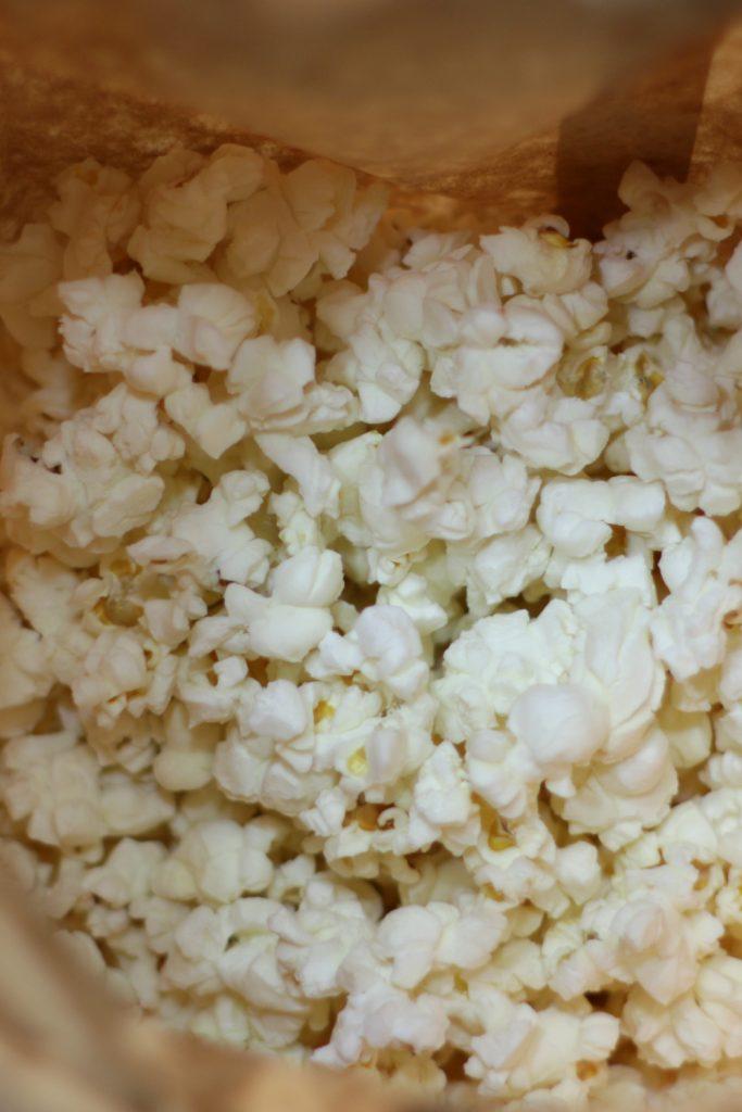 Brown paper bag of homemade microwave popcorn.