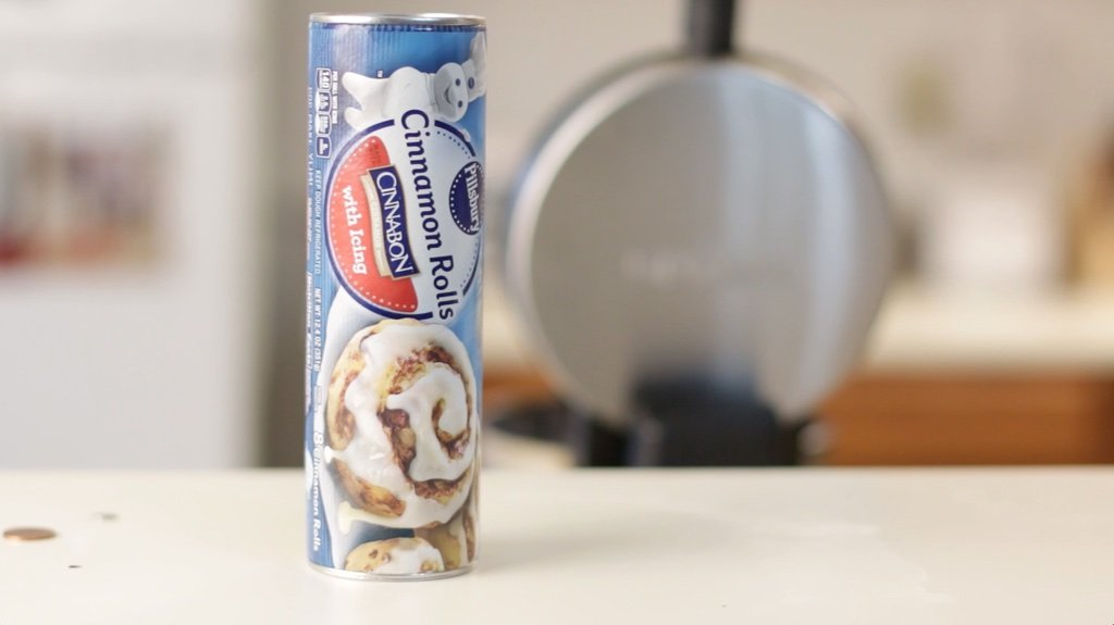 Cinnamon rolls in a container on a counter