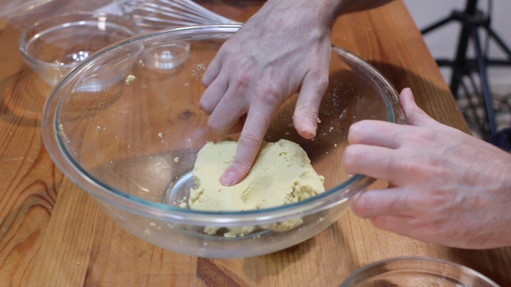 Corn tortillas dough in a large glass bowl.