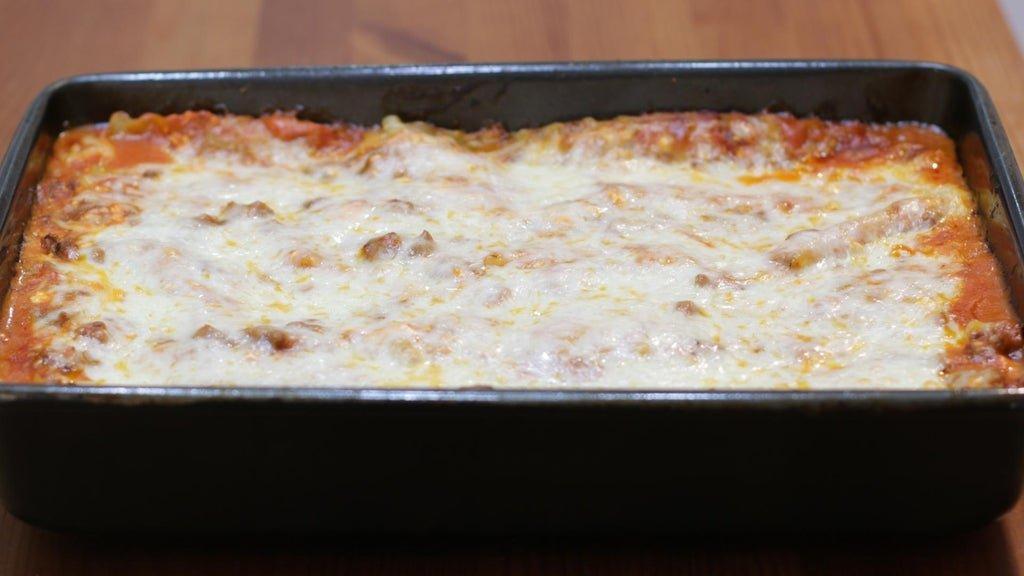 Freshly baked lasagna in a 9x13 inch pan.