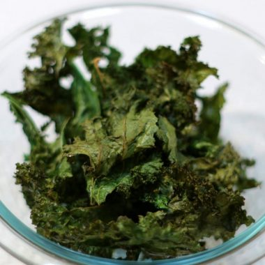 Glass bowl filled with Kale chips