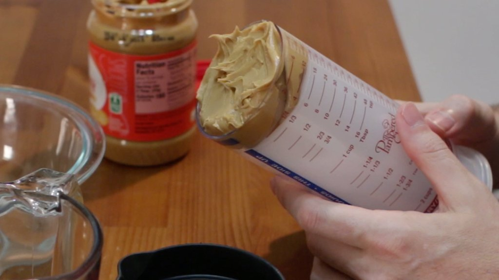 Peanut butter inside of a pampered chef measure all tool.
