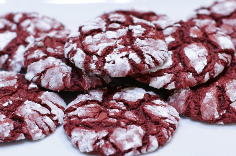 stack of red velvet cake mix crinkles on a plate