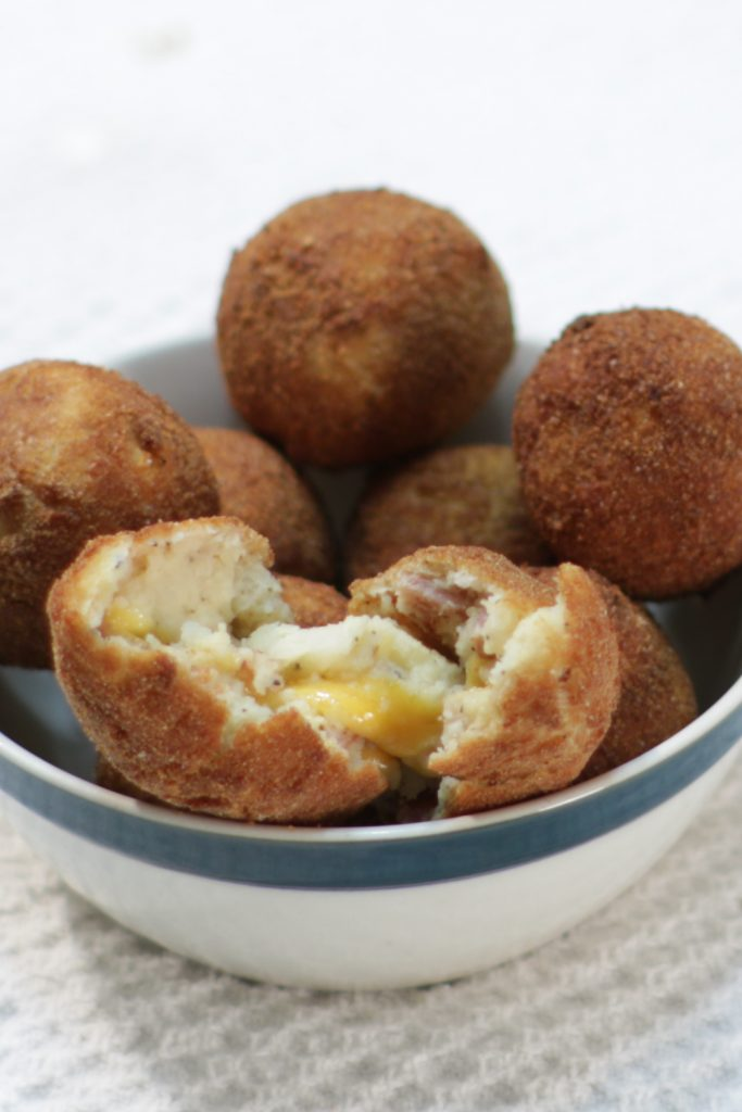 Bowl full of bacon and cheese mashed potato balls.
