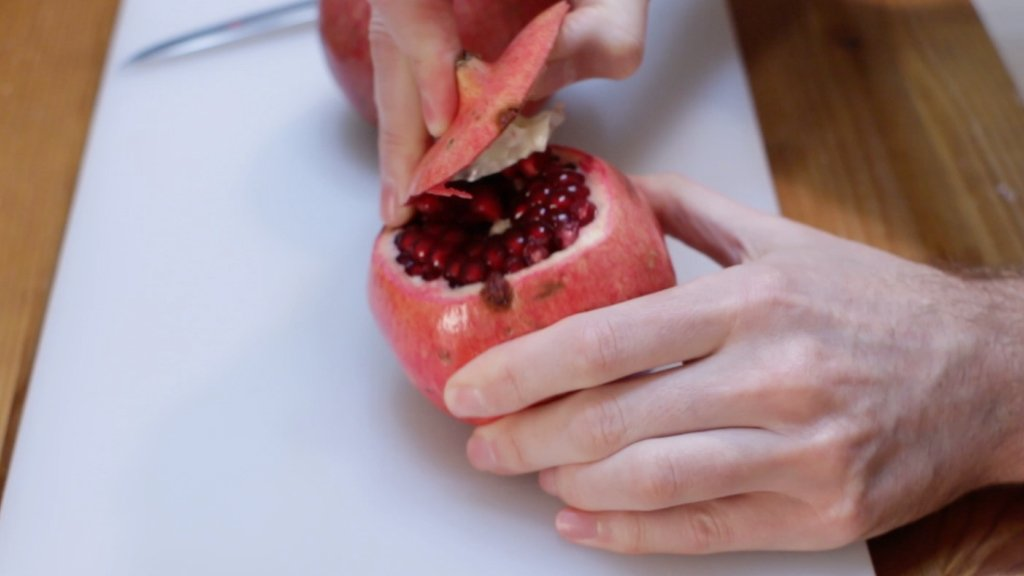 Pulling the top off of a pomegranate