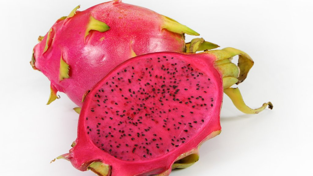 Red dragon fruit sliced in half.
