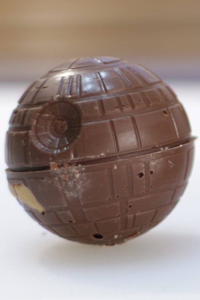 Star wars death star peanut butter cup on a white table.