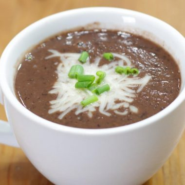 Black bean soup in a white mug