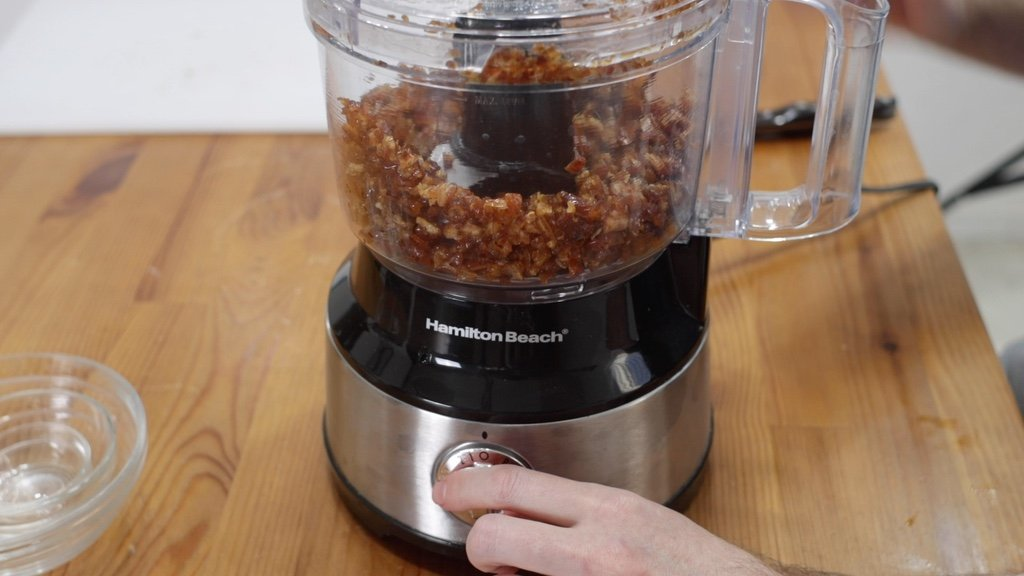 Dates being blended in a food processor.
