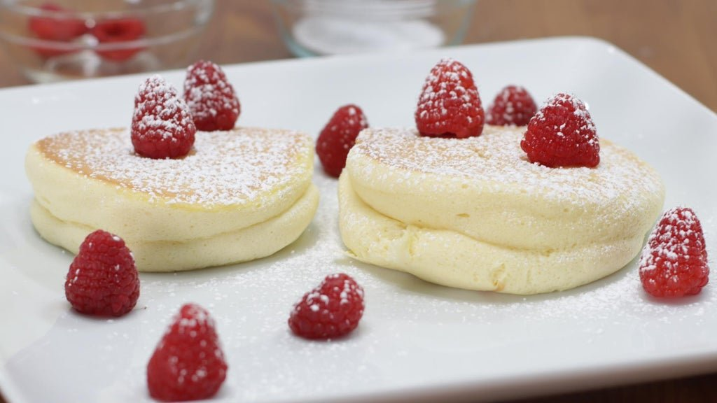 Finished Japanese souffle pancakes on a white plate.