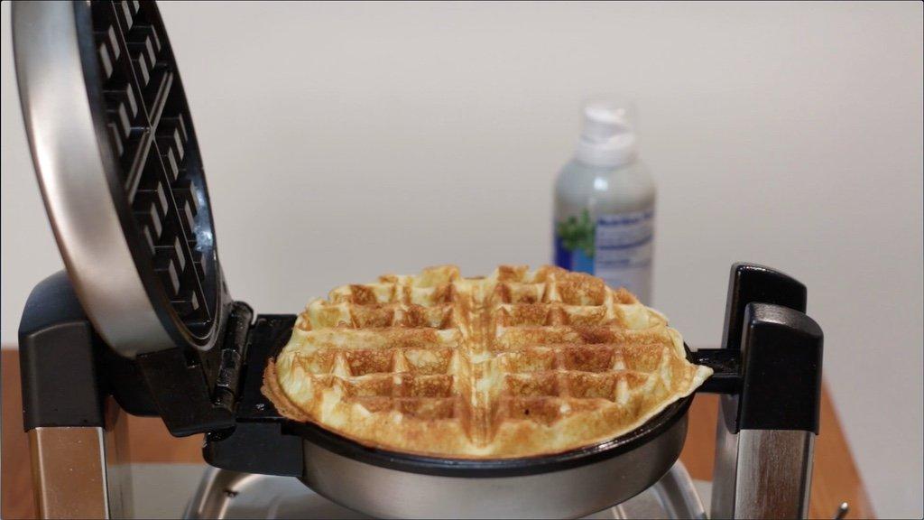 Finished cooked homemade waffle on a waffle iron.