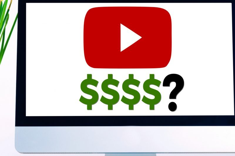 YouTube play button with green dollar signs under it
