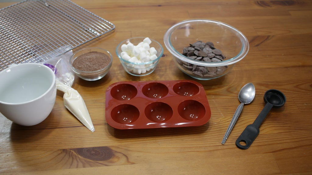 Several ingredients in bowls on a wooden table.