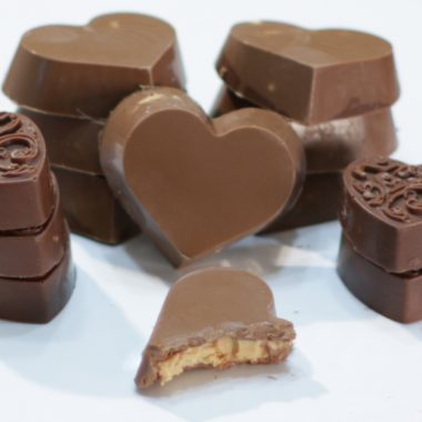 peanut butter cup hearts on a white plate.