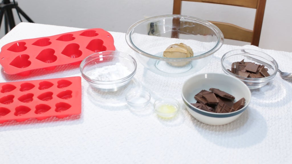 Several ingredients in glass bowls on a white table.