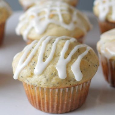 lemon poppy seed muffins on a white plate