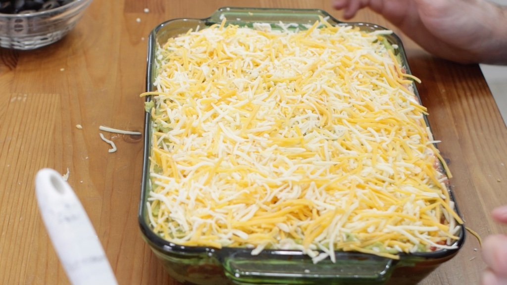 Seven layer dip with cheese on top.