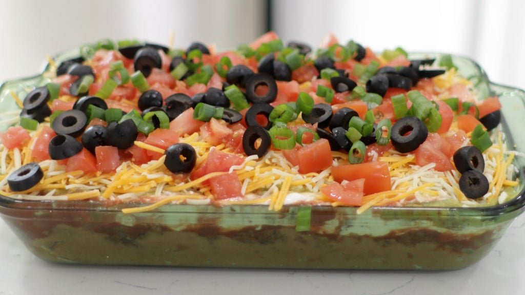 Finished 7 layer bean dip on a counter.